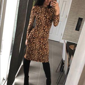 Dresses & Skirts - Leopard bodycon dress- two ways to wear it. Size S